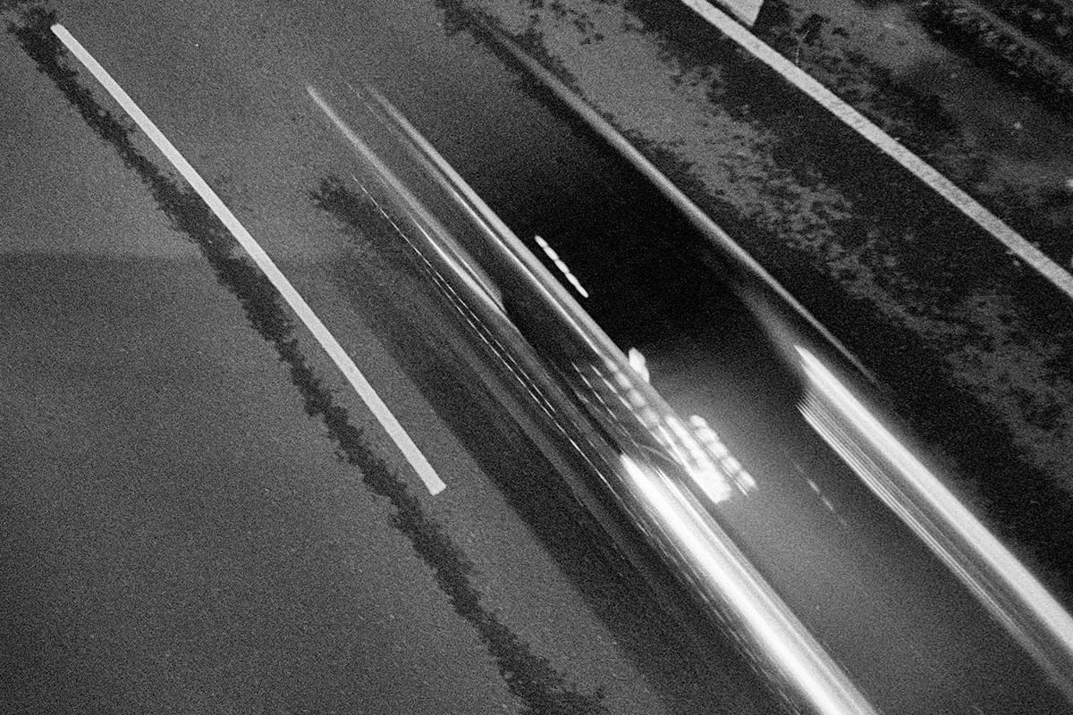Fast cars blur at night