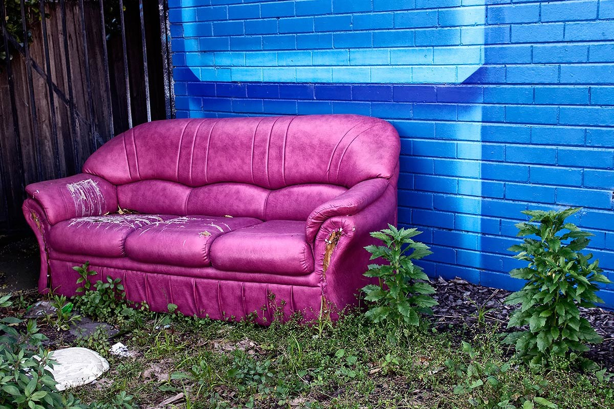 Pink/purple abandoned sofa