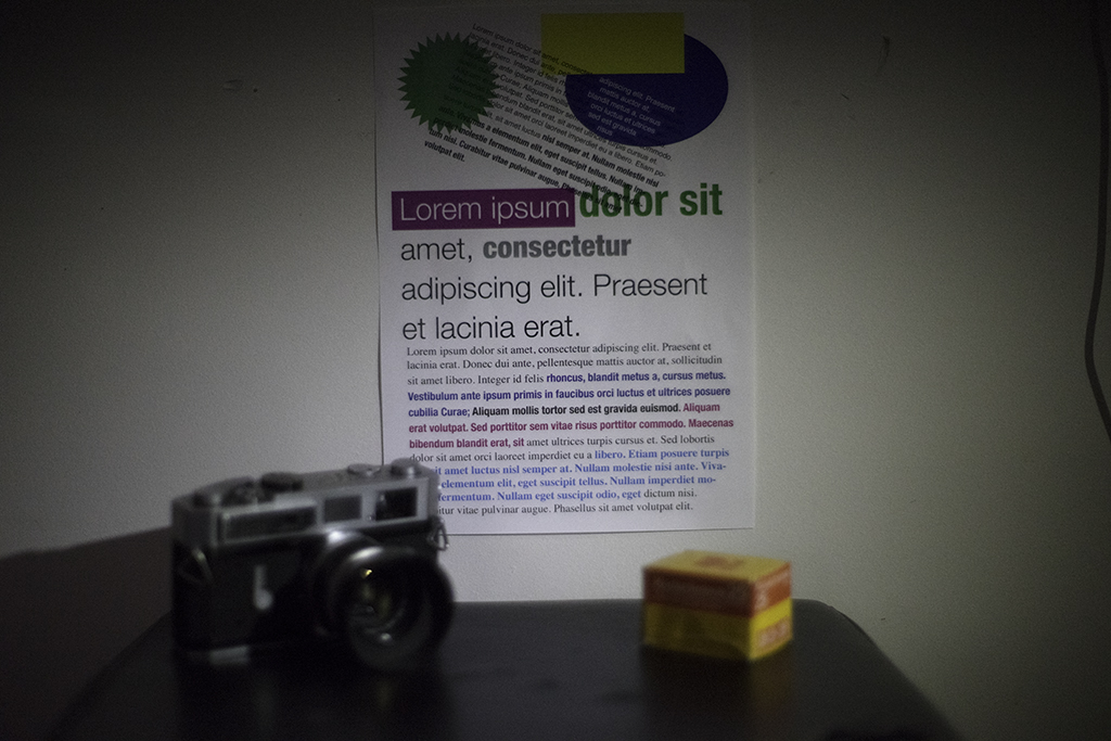 Image of camera, box of film and test chart