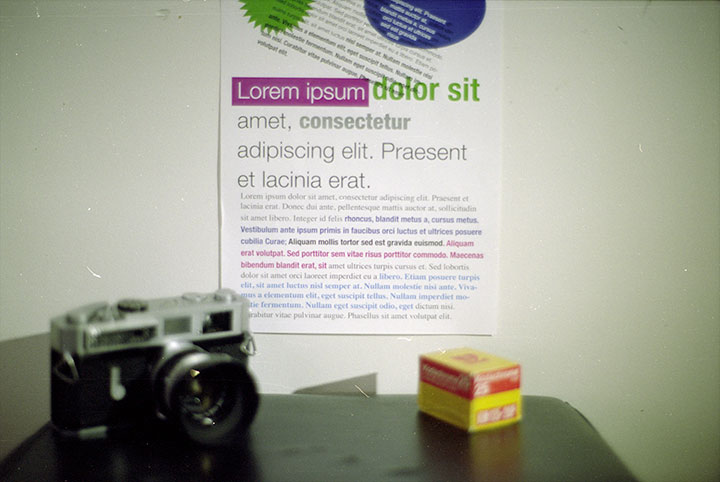 Photo of camera, box of film and test chart