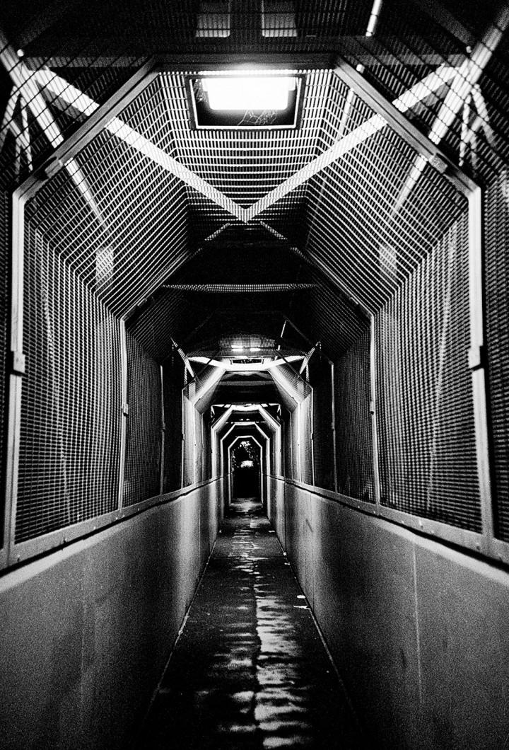 Fenced off walkway at night