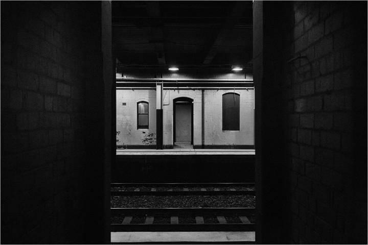 View across railway platform, from doorway.