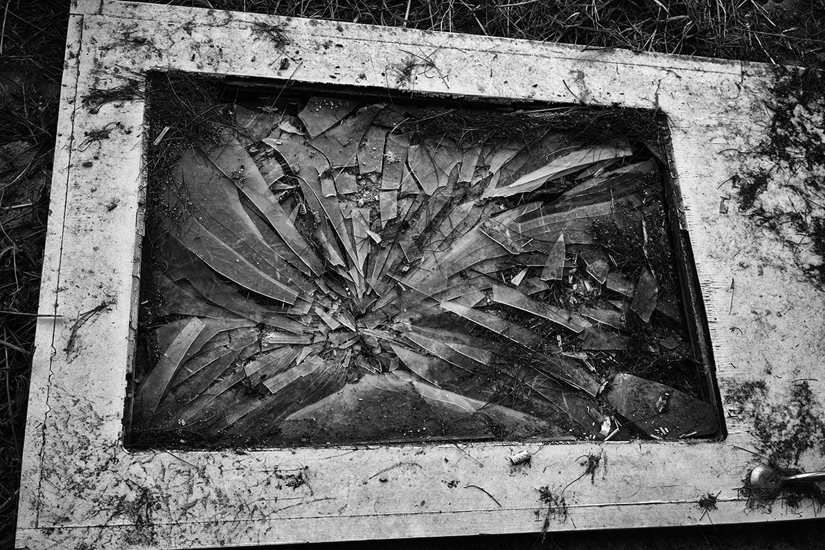 Broken glass on old door on the floor