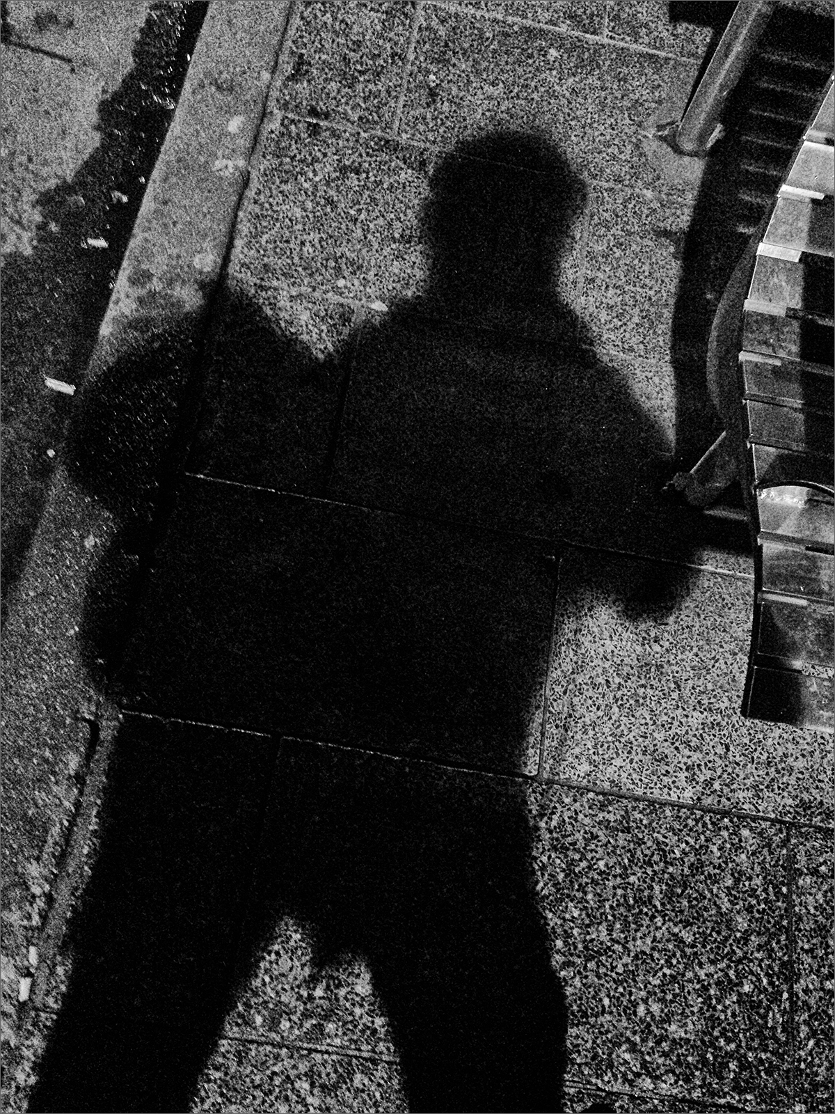 Shadow on pavement in black and white