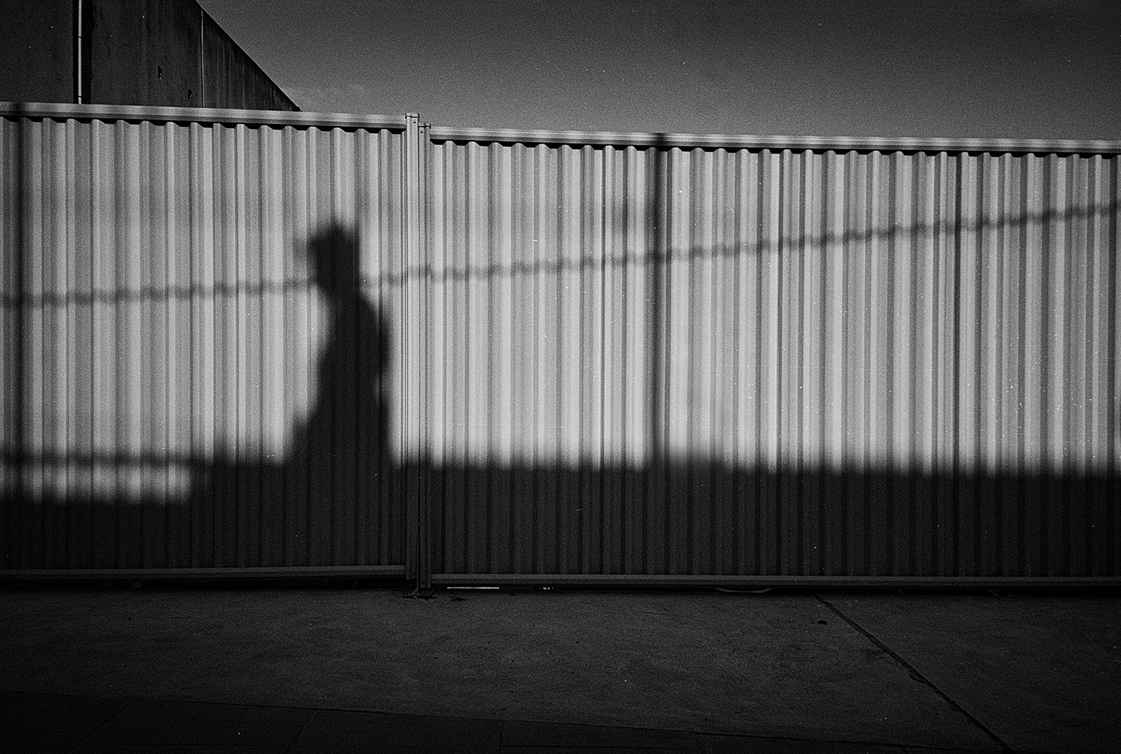 Shadow on corrugated wall, in black and white