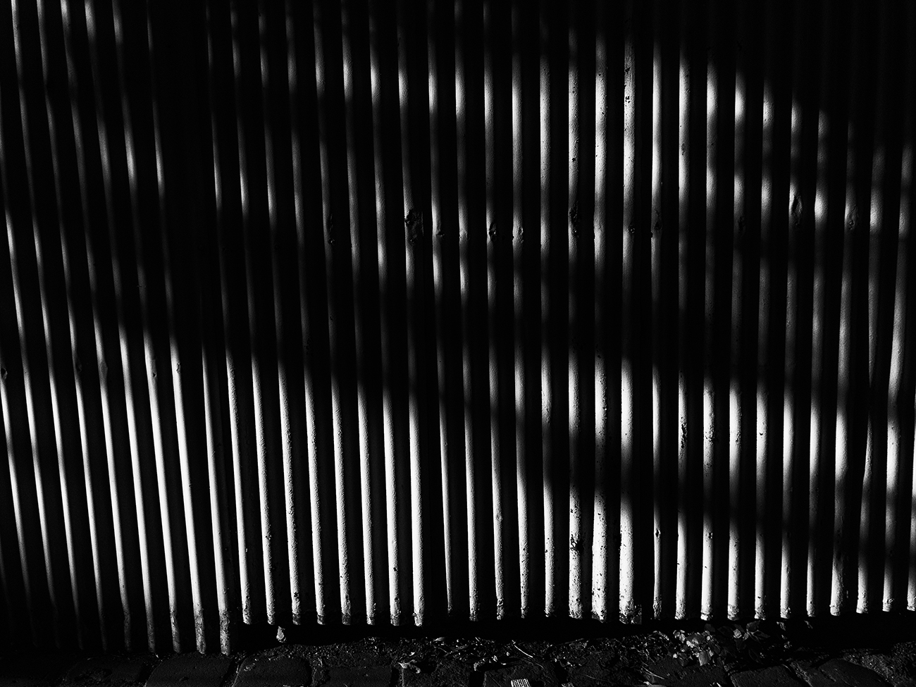 Corrugated iron fence, high contrast